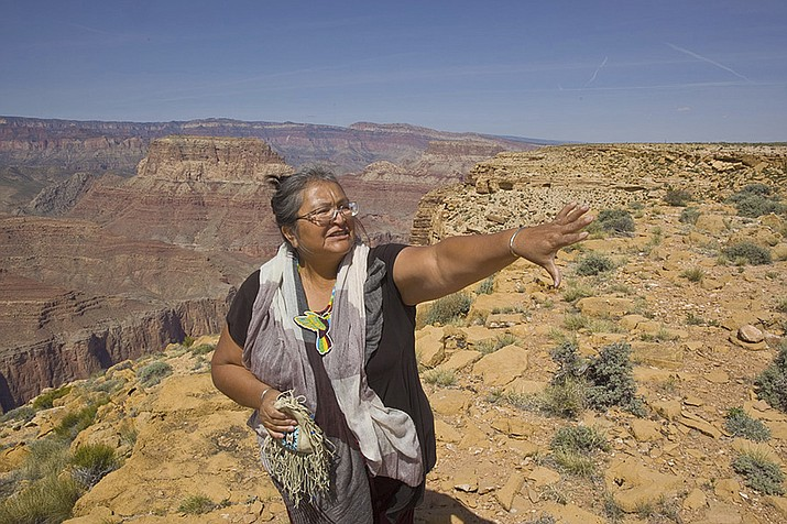 Renae Yellowhorse, a spokesperson for Save the Confluence, stands at Confluence Overlook on the East Rim of the Grand Canyon on Navajo Nation west of The Gap, Ariz. Lawmakers on the country's largest American Indian reservation have shot down the measure to build the tram that would have taken visitors to a riverside boardwalk with stores, hotels and restaurants above on the East Rim of the canyon. (Tom Bean via AP)