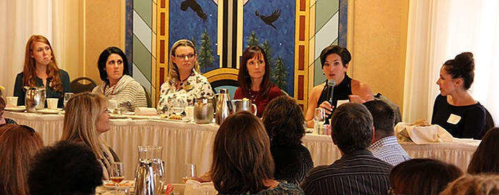 Courtney Osterfelt speaks as one of five businesswomen asked to address perceptions and mis-perceptions of millennials during a Women in Business luncheon on Wednesday, Nov. 8. (Max Efrien/Courier)