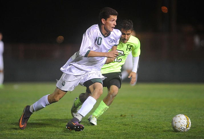 Yavapai's Carlo Quesada (10) moves the ball as the Roughriders take on Phoenix College in the semifinals of the NJCAA Region 1 soccer tournament in Prescott Wednesday night. (Les Stukenberg/Courier)