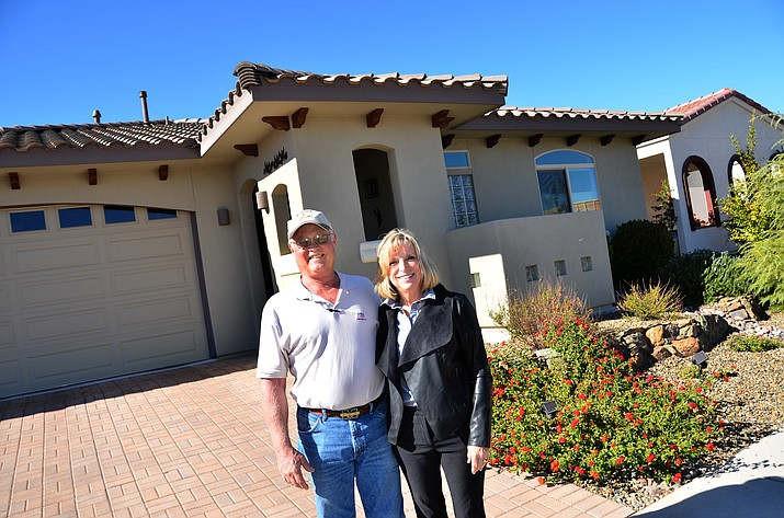 Laurie and Bill Bullock pose in front of their energy-efficient homes at Grey Fox Ridge in Cottonwood. VVN/Vyto Starinskas