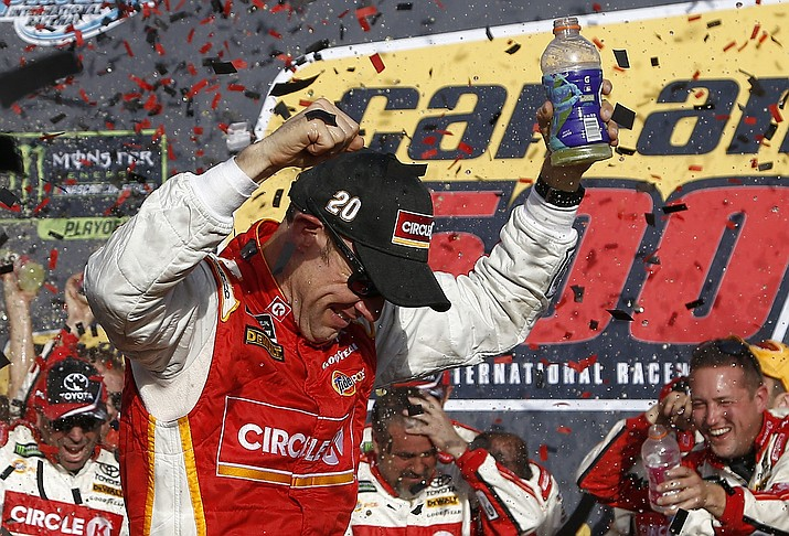 Matt Kenseth celebrates his win in Victory Lane after a NASCAR Cup Series auto race at Phoenix International Raceway Sunday, Nov. 12, 2017, in Avondale. (Ross D. Franklin/AP)