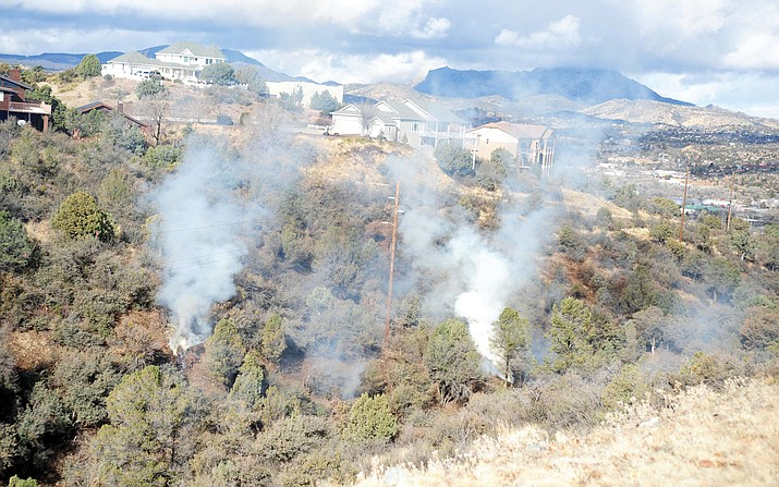 Arrow Fire Support Services LLC conducts a burn of slash piles in a canyon near Bradshaw Drive on Jan. 27, 2015, in Prescott. (Les Stukenberg/Courier, File)