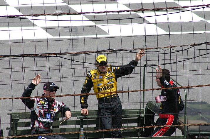 NASCAR drivers Kevin Harvick (left), Matt Kenseth (center) and Mike Bliss (right) wave to the crowd during driver introductions before the 2005 Pocono 500.