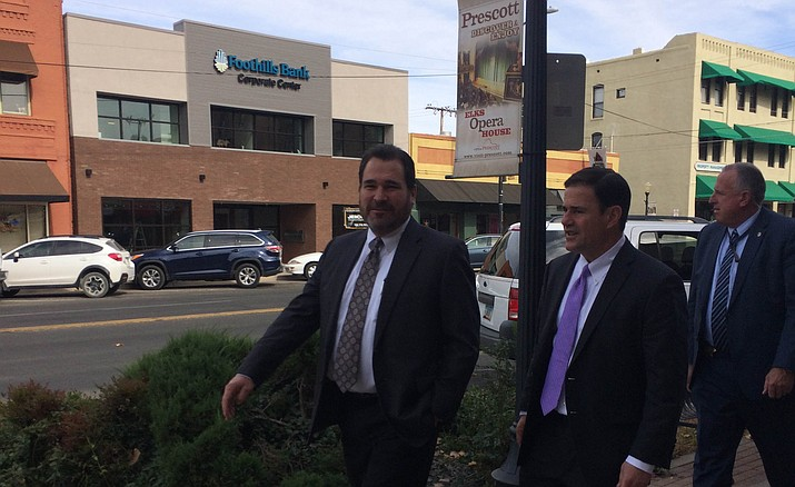 Arizona Gov. Doug Ducey, center, walks down Gurley Street with Prescott attorney Alex Vakula, left, after giving an address to the Yavapai Republican Men's Forum at the Hotel St. Michael on Monday, Nov. 13, in Prescott. (Nanci Hutson/Courier)