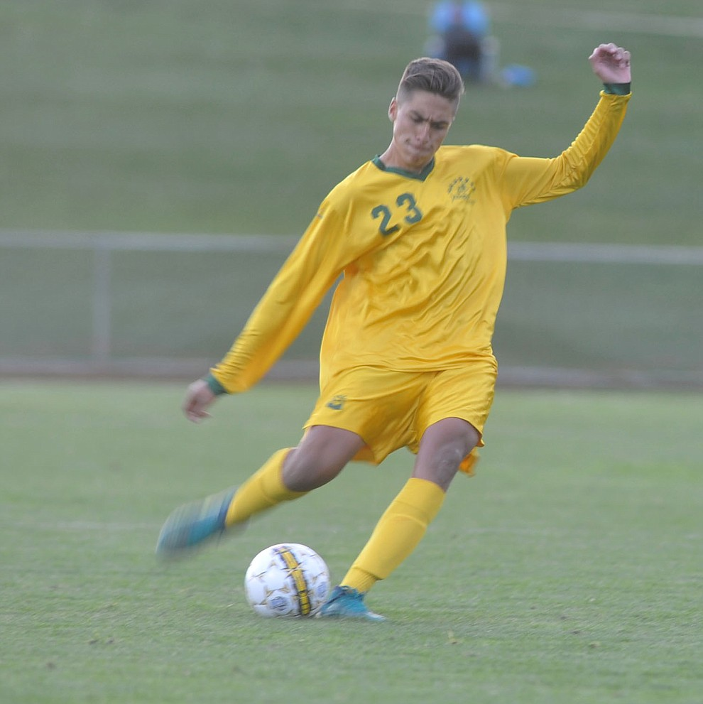 Yavapai's John Scearce send the ball upfield as the Roughriders take on Waubonsee Community College in the opening round of the NJCAA Division 1 National Championship Tuesday night in Prescott Valley. (Les Stukenberg/Courier)
