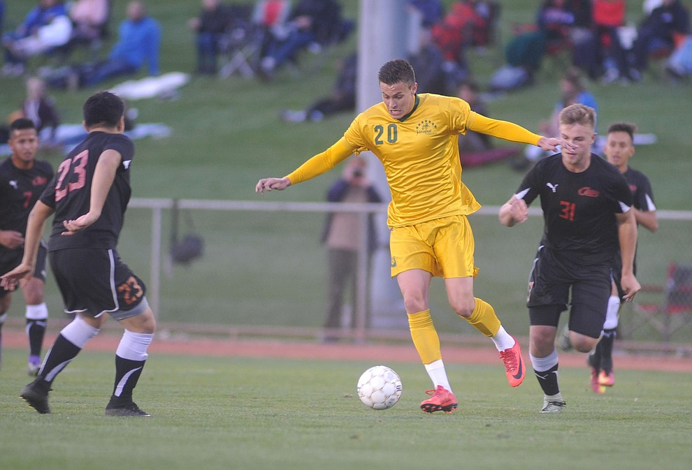 Yavapai's William Baynham maneuvers the ball between 4 defenders as the Roughriders take on Waubonsee Community College in the opening round of the NJCAA Division 1 National Championship Tuesday night in Prescott Valley. (Les Stukenberg/Courier)