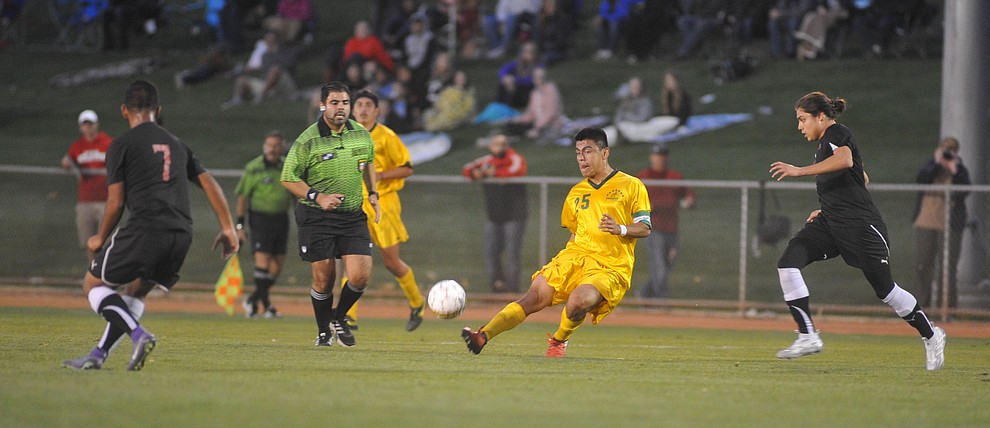 Yavapai's Jose Perez Flores sends a pass forward as the Roughriders take on Waubonsee Community College in the opening round of the NJCAA Division 1 National Championship Tuesday night in Prescott Valley. (Les Stukenberg/Courier)