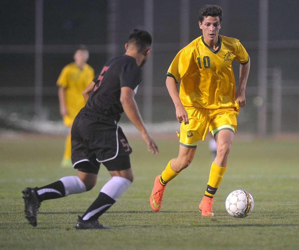 Yavapai's Carlo Quesada brings the ball upfield as the Roughriders take on Waubonsee Community College in the opening round of the NJCAA Division 1 National Championship Tuesday night in Prescott Valley. (Les Stukenberg/Courier)