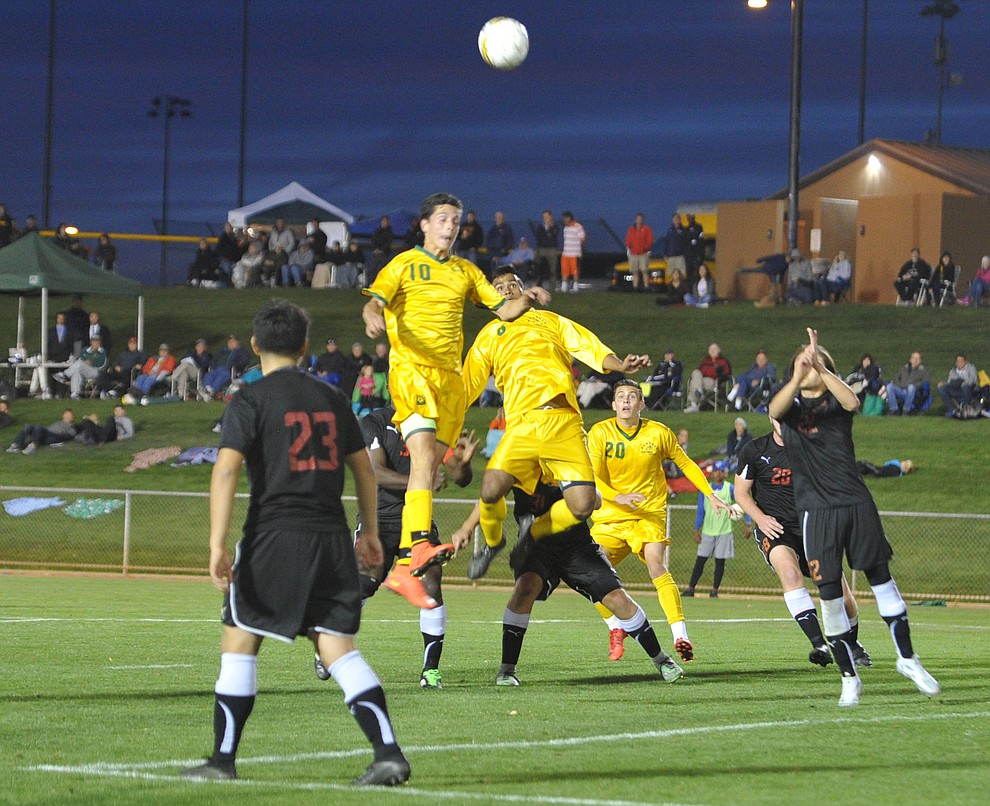Yavapai players go up on a set corner kick play as the Roughriders take on Waubonsee Community College in the opening round of the NJCAA Division 1 National Championship Tuesday night in Prescott Valley. (Les Stukenberg/Courier)