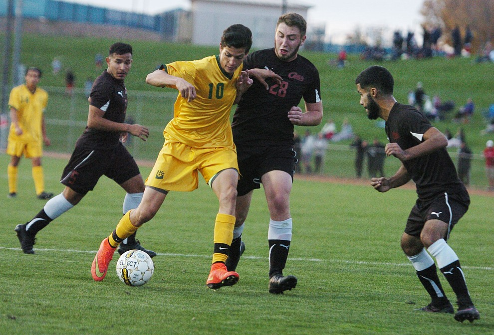 Yavapai's Carlo Quesada battles between three defenders as the Roughriders take on Waubonsee Community College in the opening round of the NJCAA Division 1 National Championship Tuesday night in Prescott Valley. (Les Stukenberg/Courier)