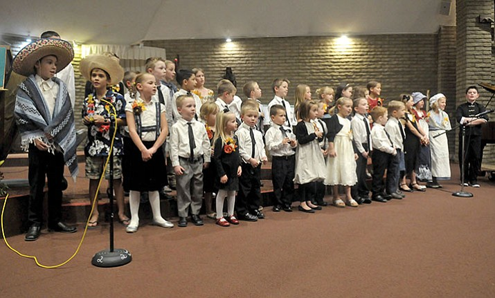 "A Children's Choir from The Church of Jesus Christ of Latter-day Saints performs dressed in outfits from cultures around the world during the 2016 Quad City Interfaith Council's ""A Celebration of Thanks"" at Sacred Heart Catholic Church in Prescott.  (Courier file photo)"