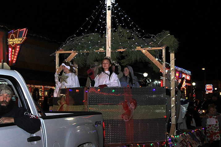 A 2016 Christmas parade float makes its way down the street in Williams.