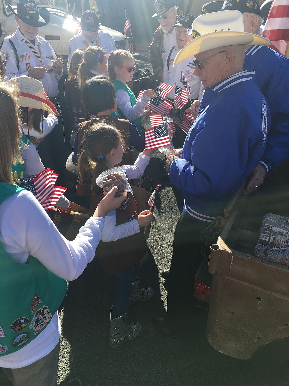 Girl Scout Troop 1653 hands out cookies and flags to veterans past and current. (Courtesy)