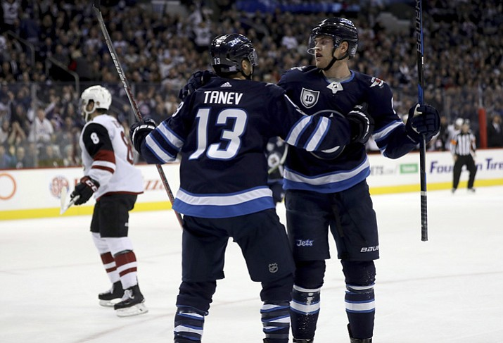 Winnipeg Jets' Brandon Tanev (13) and Andrew Copp (9) celebrate after Copp scored against the Arizona Coyotes during first period Tuesday, Nov. 14, 2017, in Winnipeg, Manitoba. (Trevor Hagan/The Canadian Press via AP)
