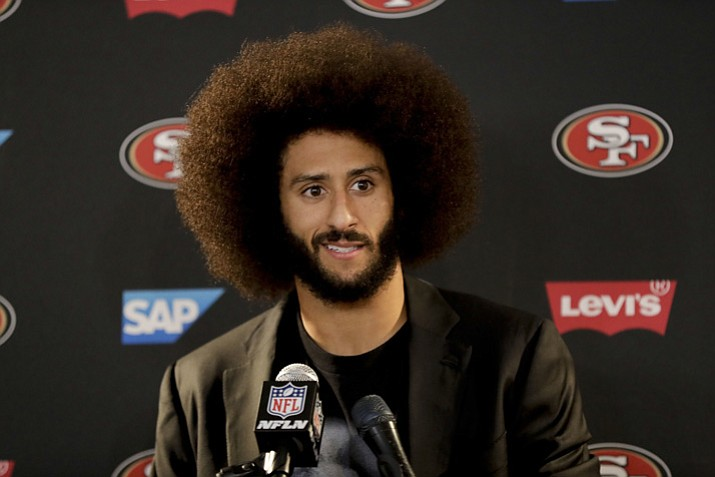 "In this Dec. 24, 2016, file photo San Francisco 49ers quarterback Colin Kaepernick talks during a news conference after an NFL football game against the Los Angeles Rams. The free agent quarterback was named GQ magazine's ""Citizen of the Year"" for his activism on Nov. 13, 2017. (Rick Scuteri/AP, File)"