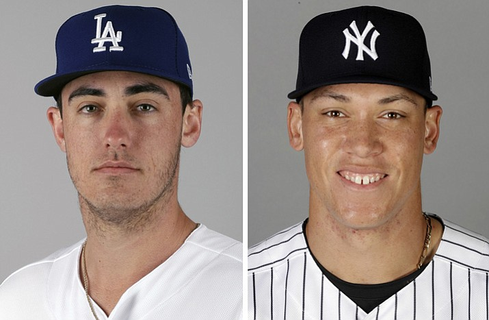 These are 2017 file photos showing Los Angeles Dodgers' Cody Bellinger, left, and New York Yankees' Aaron Judge. Aaron Judge of the Yankees and Cody Bellinger of the Dodgers are favored to win Rookie of the Year honors when the votes are announced Monday night, Nov. 13, 2017. (AP Photo, File)