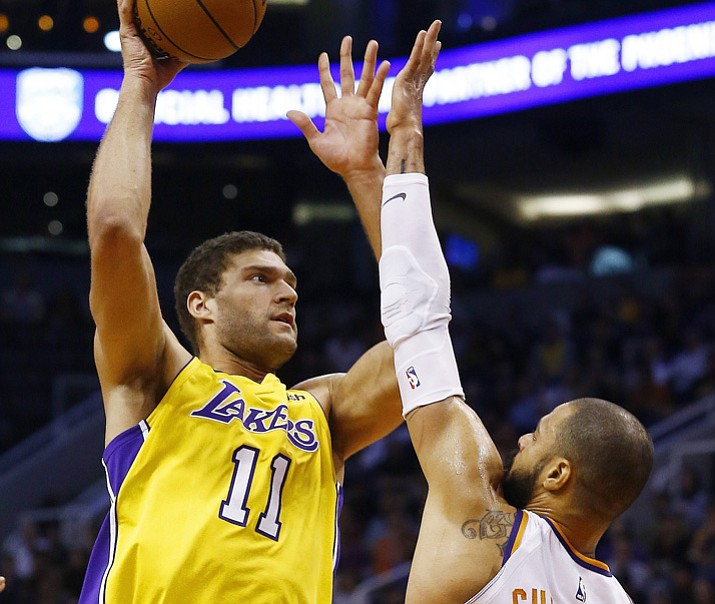 Los Angeles Lakers center Brook Lopez (11) shoots over Phoenix Suns center Tyson Chandler (4) during the first half Monday, Nov. 13, 2017, in Phoenix. (Ross D. Franklin/AP