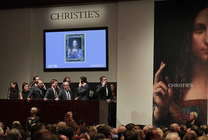 "Bidding representatives wait on phones for instructions from bidders for Leonardo da Vinci's ""Salvator Mundi"" at Christie's, Wednesday, Nov. 15, 2017, in New York. The painting sold for $400 million. (AP Photo/Julie Jacobson)"