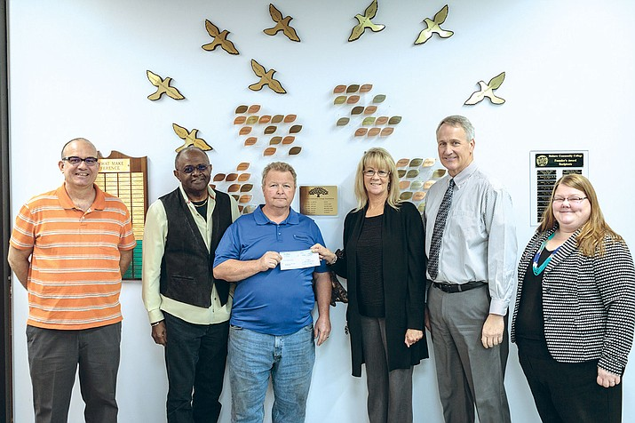 The Kingman Daily Miner on behalf of the Soldwedel family presented MCC leaders with a check for $26,000 for scholarships for years to come.  Pictured from left to right: Shawn Byrne, Miner Editor,  Dr. Fred Gilbert, Dean, Kingman Campus, Marvin Taylor, MCC Foundation Kingman Chapter President, Debbie White, Miner Publisher, Dr. Michael Kearns, MCC President, Carrie Kelly, MCC Foundation Executive Director.
