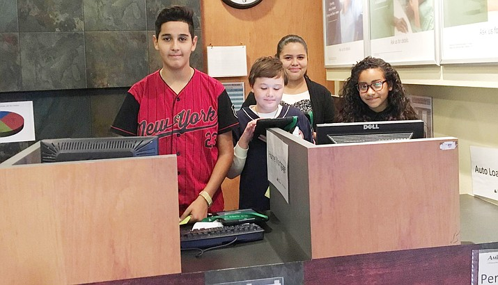 The field trip to the Junior Achievement Center in Tempe was once again a success for the seventh graders in Biztown. This is truly life-changing as students learn how to maneuver through life in the simulation given to them. (Photo courtesy of Karin Ward)