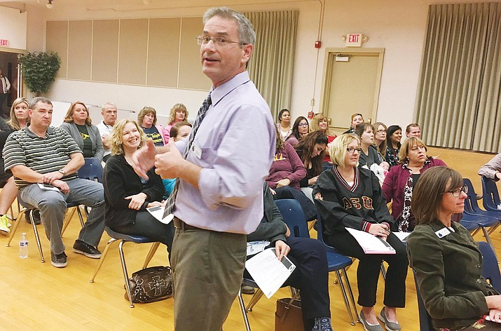 Wednesday, Cottonwood-Oak Creek Superintendent Steve King talks to a group of about 50 interested parents and community members about the possibility of the district converting three schools into two K-8 schools. (Photo by Bill Helm)
