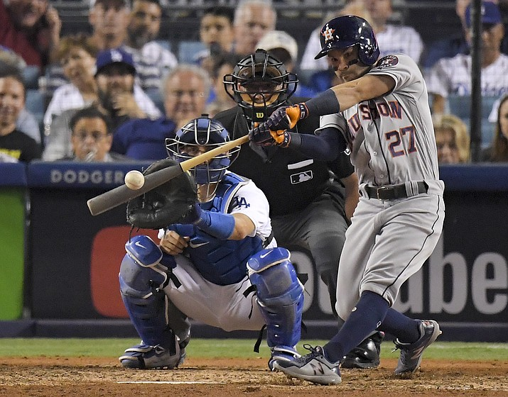 In this Oct. 25, file photo, Houston Astros' Jose Altuve hits a home run against the Los Angeles Dodgers during the 10th inning of Game 2 of baseball's World Series in Los Angeles. Houston dynamo Jose Altuve and Yankees slugger Aaron Judge are the favorites for the AL MVP award while Miami masher is the top candidate for the NL prize. (Mark J. Terrill, AP file)