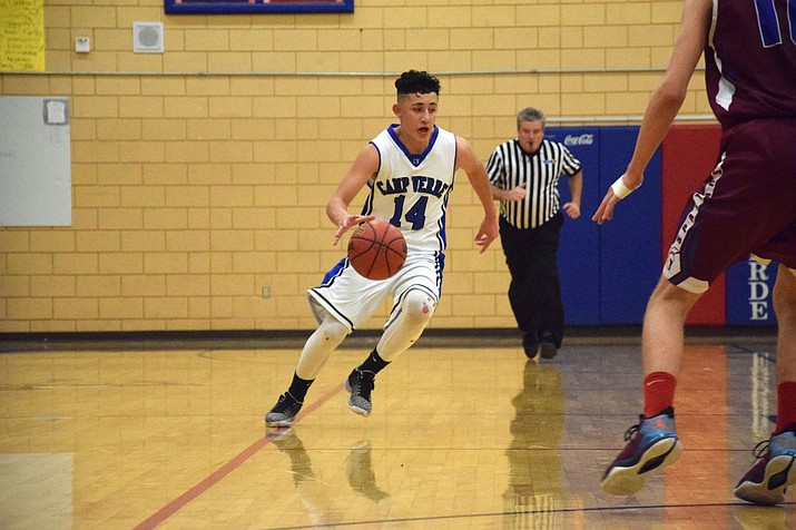 Camp Verde guard/forward Abe Gonzalez takes the ball up the court during a game last season. Gonzalez was second team all-region last year.  (VVN/James Kelley)
