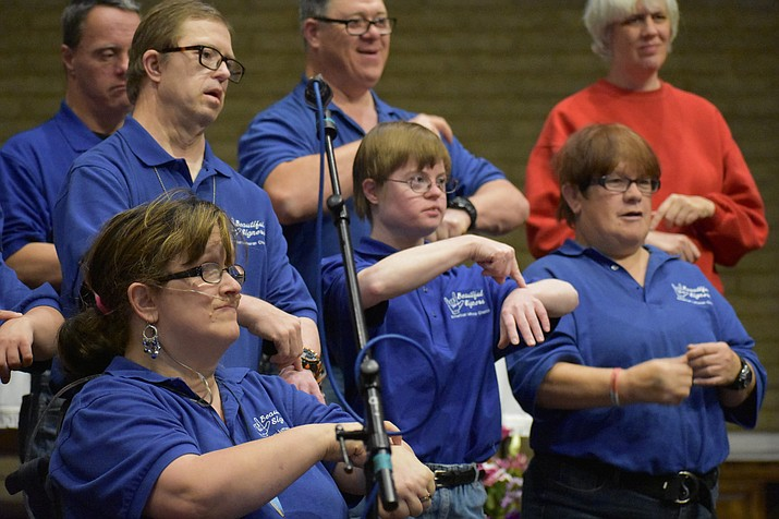 "The ""Beautiful Singers"" sign language choir from American Lutheran Church perform during the 2017 Celebration of Thanks at Sacred Heart Church in Prescott. (Richard Haddad/WNI)"