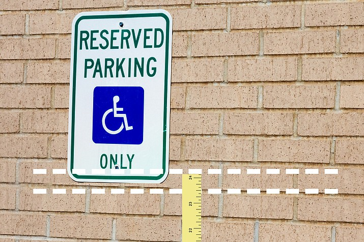 Taking a small business to court because their handicap parking sign is an inch or two too high or too low is the perfect definition of a frivolous lawsuit. (WNI Illustration)