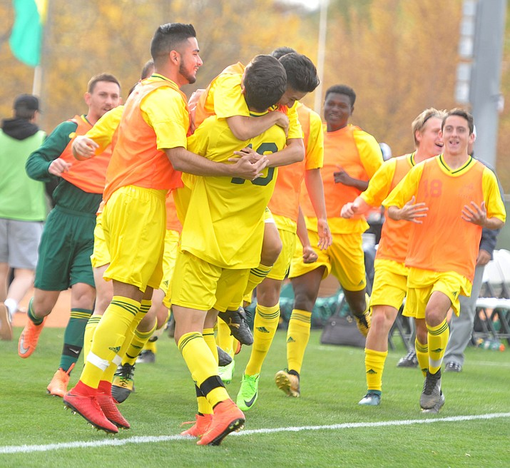 Yavapai's Carlo Quesada (10) gets mobbed by his team mates after the first goal as the Roughriders take on Mercer County Community College in the second round of the NJCAA Division 1 National Championship Wednesday afternoon in Prescott Valley. (Les Stukenberg/Courier)