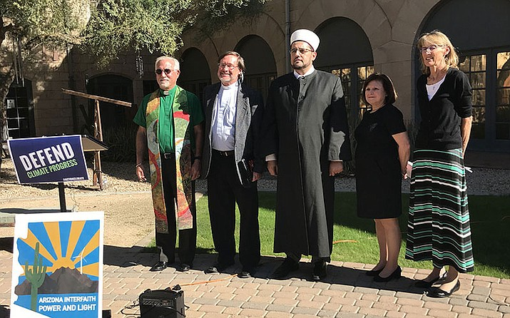 Faith leaders called on Arizona senators to fight climate change at a news conference at Trinity Episcopal Cathedral in Phoenix. From left to right:  Pastor Doug Bland, the Rev. Stephen Keplinger, Imam Didmar Faja, Rabbi Bonnie Sharfman and Sarah King of Earth Care Commission posed for photos after the news conference.