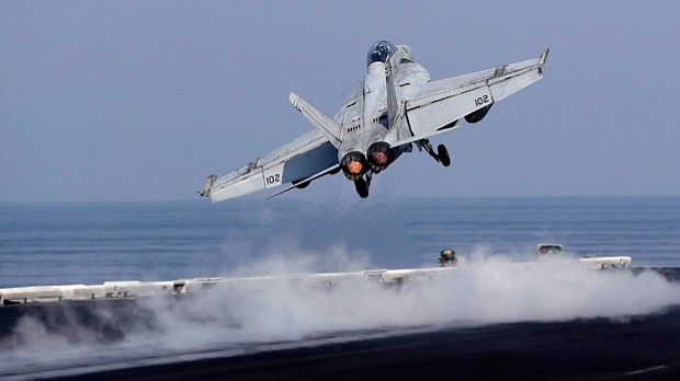 U.S. Navy fighter jet takes off from the deck of the U.S.S. Dwight D. Eisenhower aircraft carrier. Officials for Naval Air Station Whidbey Island say one of their planes created sky writings in the shape of male genitals in the skies over a rural Washington community on Thursday, Nov. 16. (2016 AP File, Petr David Josek)