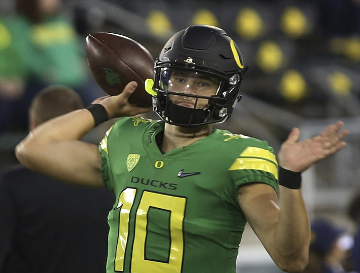 In this Sept. 30, 2017, file photo, Oregon quarterback Justin Herbert warms up before game against California in Eugene, Ore. (Chris Pietsch/AP, File)