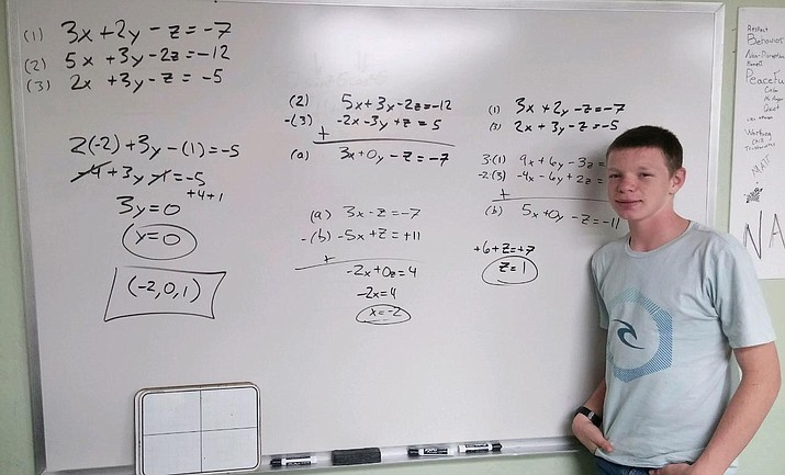 Mathew Matthias is pictured tackling greater systems of equations and solving them by adding equations. (Photo courtesy Camp Verde Unified School District)