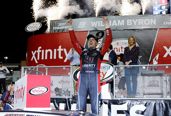 William Byron celebrates in Victory Lane after winning the NASCAR Xfinity Series auto racing season championship, Saturday, Nov. 18, 2017, at Homestead-Miami Speedway in Homestead, Fla. (Terry Renna/AP)