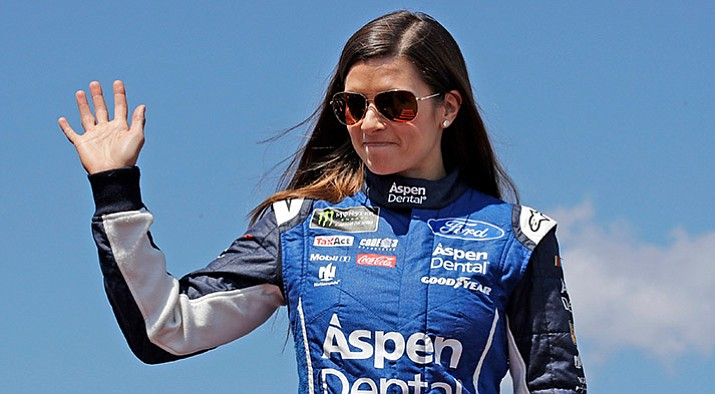 Danica Patrick poses prior to the NASCAR Cup Series auto race at the New Hampshire Motor Speedway in Loudon, N.H. Patrick announced plans Friday, Nov. 17, 2017, to run only two races in 2018, the Daytona 500 and the Indianapolis 500. (Charles Krupa/AP, File)