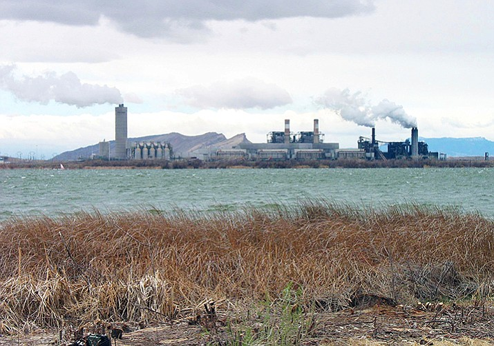 This April, 2006 file photo shows the Four Corners Power Plant in Waterflow, N.M., near the San Juan River in northwestern New Mexico. Unions that represent Navajo workers say contractors at a northwestern New Mexico power plant are violating tribal labor laws. The tribe enacted the Navajo Preference in Employment Act in 1985, requiring the hiring of qualified Navajos over other applicants, to keep Navajos working on the reservation where jobs are scarce. (AP Photo/Susan Montoya Bryan, File)
