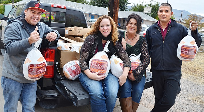The Old Town Mission gets 50 turkeys Friday donated by Larry Green of Larry Green Chevrolet in Cottonwood. Thanksgiving meal boxes will be given away at the Mission Nov. 21. (VVN/Vyto Starinskas)