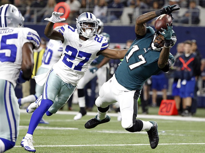 Dallas Cowboys cornerback Jourdan Lewis (27) defends as Philadelphia Eagles wide receiver Alshon Jeffery (17) catches a pass for a touchdown in the second half of an NFL football game, Sunday, Nov. 19, in Arlington, Texas. (Michael Ainsworth/AP)
