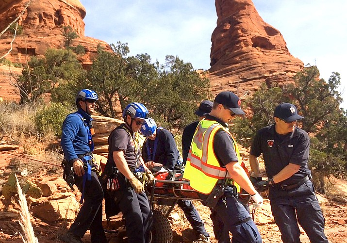 An injured hiker was carried off the Boynton Spur Trail by Sedona Fire Department personnel Monday after a technical rescue off the side of steep red rocks. (VVN/Vyto Starinskas)
