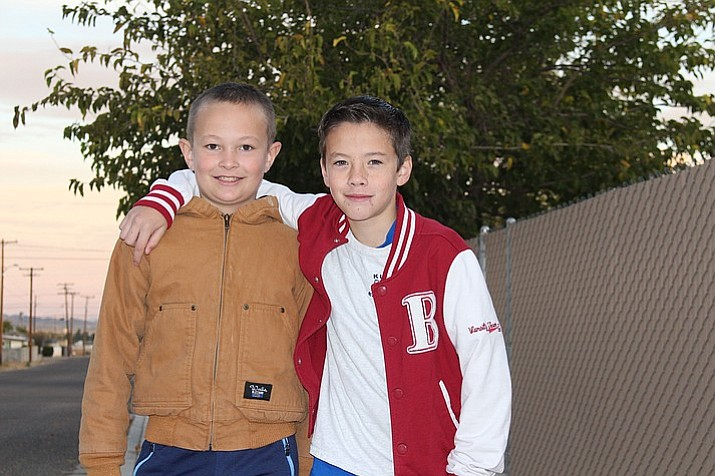 Brennon McKinney, left, and Evan Bond are best friends at Manzanita Elementary School in Kingman, Arizona. Brennon performed the Heimlich maneuver when his friend was choking on a piece of candy at the school bus stop. (Hubble Ray Smith/Kingman Daily Miner)