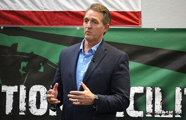 U.S. Sen. Jeff Flake, R-Ariz., told aerospace company workers that corporate tax cuts are needed to restore America's global competitiveness. (Bob Christie/AP)