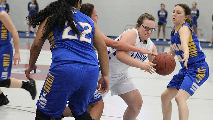 Prep Basketball: Lady Tigers claw their way to first win over Lady Bulldogs