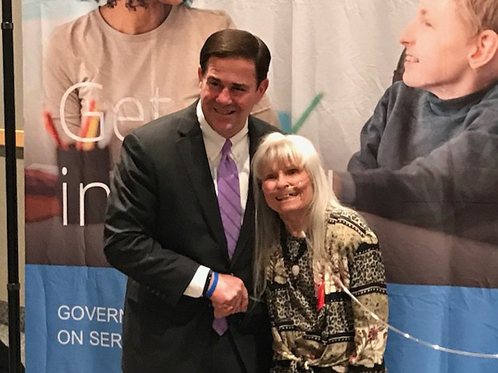 Gov. Doug Ducey recognizes Carol Glassburn for her years of volunteer work in the Williams community Nov. 2.