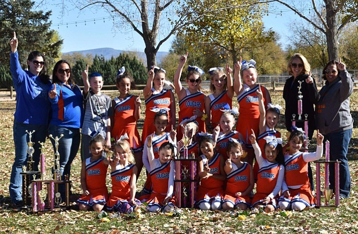 The Chino Valley minors cheerleaders pose for a photo Saturday, Nov. 18, at Memory Park in Chino Valley, after earning first place during the Northern Arizona Youth Football cheerleading competition, which took place at Prescott Mile High Middle School the week prior. The event originally named the wrong winner, but the league made things right Saturday in awarding Chino Valley's cheer squad. The cheerleaders re-performed their routine in front of friends and family before being surprised with the trophy. (Melissa Bates/Courtesy)