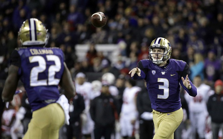 Washington quarterback Jake Browning (3) throws a pass to Lavon Coleman for a 6-yard touchdown against Utah during the first half of an NCAA college football game Saturday, Nov. 18, 2017, in Seattle. (Elaine Thompson/AP, File)