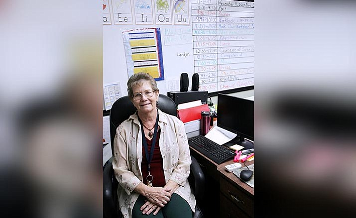 """Ready to retire from American Heritage Academy's Camp Verde campus, Maloy Sasser has been what Principal Lance Barnes calls the """"heart and soul of the school."""" (Photo by Bill Helm)"""