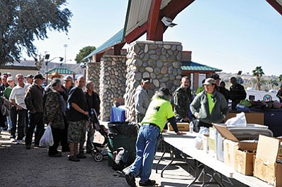 In this file photo, veterans and their friends and family stand in line for services in 2015 at the Tri-State Veterans Stand Down sponsored by the Jerry Ambrose Veterans Council. JAVC is seeking donations in its fight against the ongoing problems of veterans suffering from homelessness, being at-risk of becoming homeless or suicidal and are spent in Mohave County.
