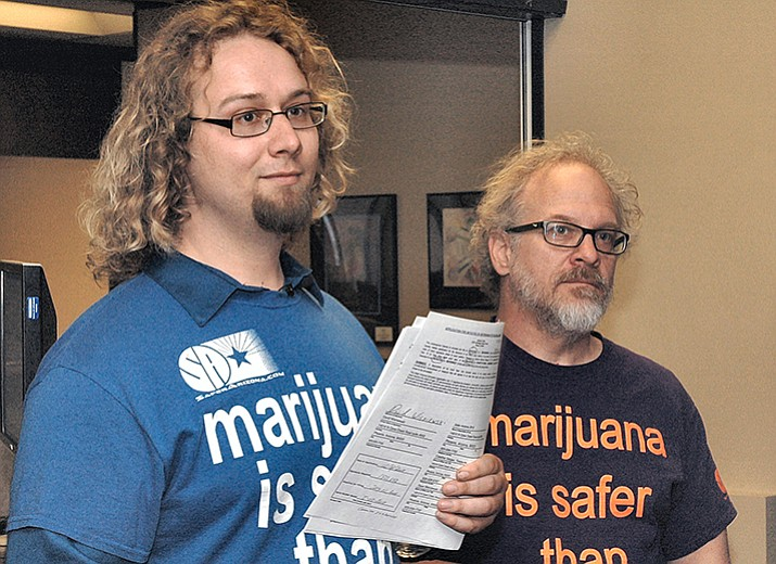David Wisniewski and Alex Gentry when they filed their paperwork earlier this year to put a marijuana legalization measure on the 2018 ballot. Wisniewski said this week he intends to continue gathering signatures despite polling suggesting the initiative would fail in an off-year election. (Howard Fischer/CMS file)