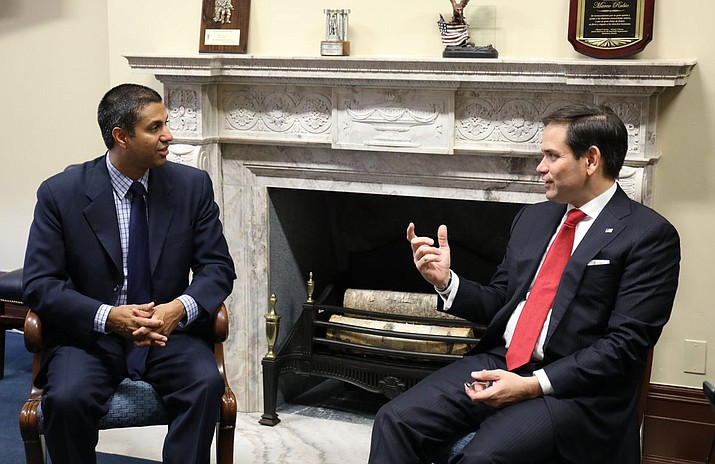 "Federal Communications Commission Chairman Ajit Pai with Sen. Marco Rubio. Pai has come up with a plan to repeal ""net neutrality"" regulations enacted under the Obama administration."